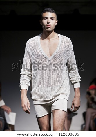 NEW YORK - SEPTEMBER 11: Model walks the runway for Lars Andersson Collection during Spring/Summer 2013 at Mercedes-Benz Fashion Week in Grand Soho Yard on September 11, 2012 in New York - stock photo