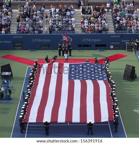 NEW YORK - SEPTEMBER 8: National anthem & flag presentaiton with National Guards at Serena Williams of USA versus Victoria Azarenka of Belarus final at USTA National Tennis Center on Sep 9 2013 in NYC - stock photo