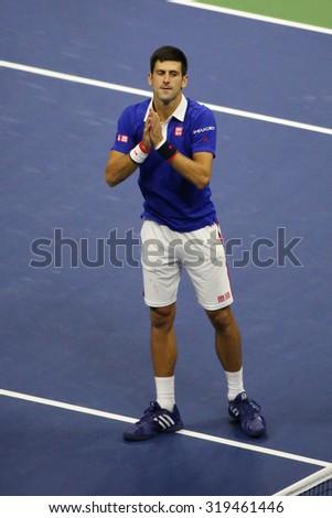 NEW YORK - SEPTEMBER 13, 2015: Nine times Grand Slam  champion Novak Djokovic celebrates victory after men's final match at US OPEN 2015 at Billie Jean King National Tennis Center in NY - stock photo