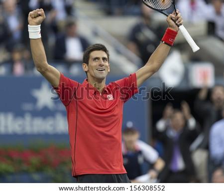 NEW YORK - SEPTEMBER 9: Novak Djokovic of Serbia reacts during US Open final match against Rafael Nadal of Spain at USTA Billie Jean King National Tennis Center on September 9, 2013 in New York City - stock photo