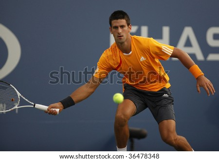 NEW YORK - SEPTEMBER 3: Novak Djokovic of Serbia returns a shot during 2nd round match against Carsten Ball of Australia at US Open on September 3, 2009 in New York. - stock photo