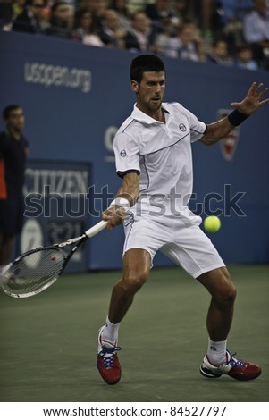 NEW YORK - SEPTEMBER 12: Novak Djokovic of Serbia returns ball during final match against Rafael Nadal of Spain at USTA Billie Jean King National Tennis Center on September 12, 2011 in NYC - stock photo
