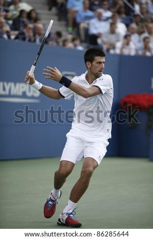 NEW YORK - SEPTEMBER 12: Novak Djokovic of Serbia returns ball during final match against Rafael Nadal of Spain at USTA Billie Jean King National Tennis Center on September 12, 2011 in New York City, NY. - stock photo