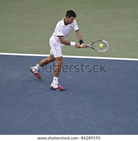 NEW YORK - SEPTEMBER 12: Novak Djokovic of Serbia returns ball during final match against Rafael Nadal of Spain at USTA Billie Jean King National Tennis Center on September 12, 2011 in NYC