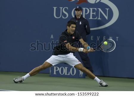 NEW YORK - SEPTEMBER 5: Novak Djokovic of Serbia returns ball during quarterfinal match against Mikhail Youzhny of Russia  at USTA Billie Jean King National Tennis Center on September 5, 2013 in NYC - stock photo