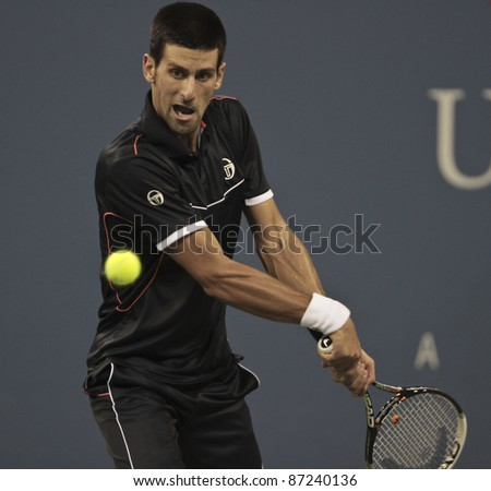 NEW YORK - SEPTEMBER 03: Novak Djokovic of Serbia returns ball during 3rd round match against Nikolay Davydenko of Russia at USTA Billie Jean King National Tennis Center on September 03, 2011 in New York City, NY. - stock photo