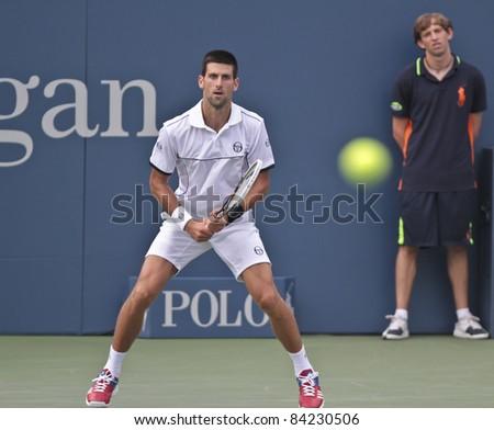 NEW YORK - SEPTEMBER 05: Novak Djokovic of Serbia returns ball during 4th round match against Alexandr Dolgopolov of Ukraine at USTA Billie Jean King National Tennis Center on September 05 2011 in NYC - stock photo