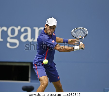 NEW YORK - SEPTEMBER 2: Novak Djokovic of Serbia returns ball during 4th round match against Julien Benneteau of France at US Open tennis tournament on September 2, 2012 in Flushing Meadows New York - stock photo