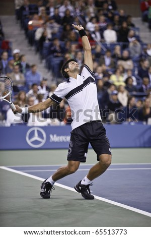 NEW YORK - SEPTEMBER 13: Novak Djokovic of Serbia returns the ball during final match of US Open Tennis Championship against Rafael Nadal on September 13, 2010 in New York, City. - stock photo