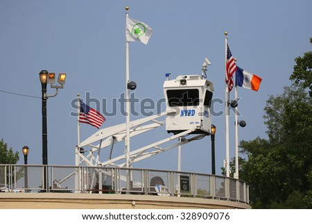 NEW YORK - SEPTEMBER 1, 2015: NYPD Sky Watch platform placed near National Tennis Center in Flushing. SkyWatch platform provides flexible surveillance options for high level security