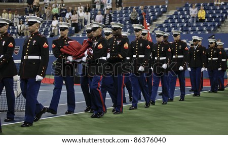 NEW YORK - SEPTEMBER 10: Opening ceremony with National Guards before semifinal match between Caroline Wozniacki of Denmark and Serena Williams of USA at US Open on September 10, 2011 in NYC - stock photo
