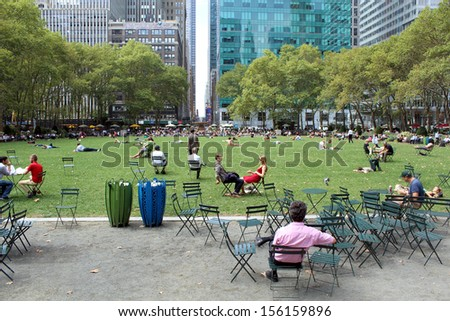 NEW YORK -SEPTEMBER 03: People enjoying at lunch time in Bryant Park on September 03, 2013 in New York City, NY. Bryant Park is a 9,603 acre privately managed park in the center of Manhattan  - stock photo