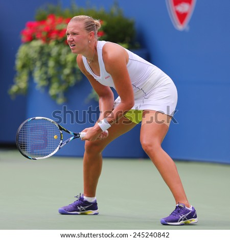 NEW YORK - SEPTEMBER 1, 2014: Professional tennis player Kaia Kanepi from Estonia during US Open 2014 match against Grand Slam Champion Serena Williams at Billie Jean King National Tennis Center  - stock photo