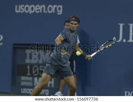 NEW YORK - SEPTEMBER 9: Rafael Nadal of Spain returns ball during US Open final match against Novak Djokovic of Serbia at USTA Billie Jean King National Tennis Center on September 9, 2013 in NYC - stock photo