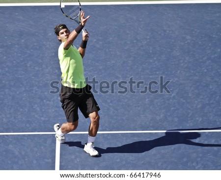 NEW YORK - SEPTEMBER 05: Rafael Nadal of Spain returns the ball during match against Gilles Simon of France at US Open Tennis Championship on September 05, 2010 in New York, City. - stock photo