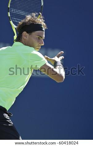 NEW YORK - SEPTEMBER 05: Rafael Nadal of Spain returns the ball during third round match against Gilles Simon of France at US Open tennis tournament on September 05, 2010, New York. - stock photo