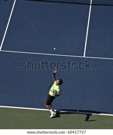 NEW YORK - SEPTEMBER 05: Rafael Nadal of Spain serves during third round match against Gilles Simon of France at US Open tennis tournament on September 05, 2010, New York. - stock photo