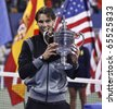 NEW YORK - SEPTEMBER 13: Rafael Nadal of Spain with the trophy after final match of US Open Tennis Championship against Novak Djokovic of Serbia on September 13, 2010 in New York, City. - stock photo