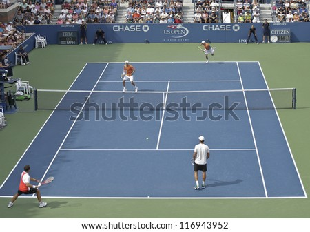 NEW YORK - SEPTEMBER 3: 3rd round match between Bob & Mike Bryan of USA & Scott Lipsky of USA, Santiago Gonzalez of Mexico at US Open tennis on September 3, 2012 in Flashing Meadows New York City - stock photo