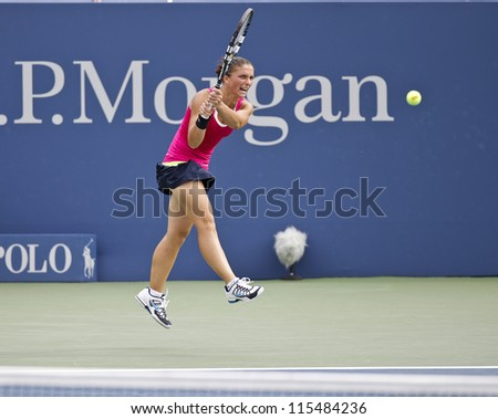 NEW YORK - SEPTEMBER 03: Sara Errani of Italy returns ball during 4th round match against Angelique Kerber of Germany at US Open tennis tournament on September 3, 2012 in Flashing Meadows New York