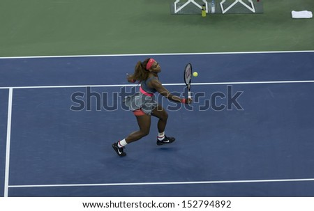 NEW YORK - SEPTEMBER 3: Serena Williams of USA returns ball during quarterfinal match against Carla Suarez Navarro of Spain at USTA Billie Jean King Tennis Center on September 3, 2013 in New York CIty