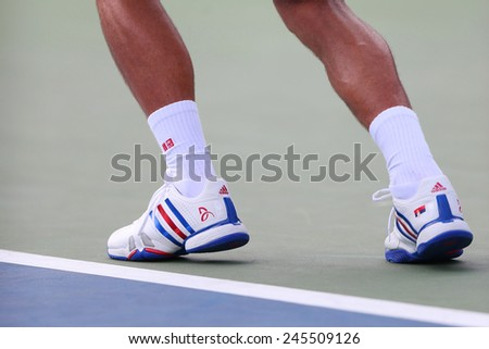 NEW YORK - SEPTEMBER 1, 2014: Six times Grand Slam champion Novak Djokovic wears custom Adidas tennis shoes during match at US Open 2014 at Billie Jean King National Tennis Center in New York - stock photo