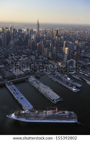 NEW YORK - September. 2009. The cruise ship Carnival passes the Manhattan skyline along Hudson river on September. 29th, 2009 in Manhattan, New York. - stock photo