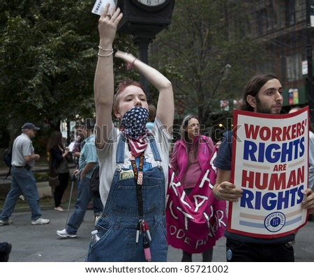 NEW YORK - SEPTEMBER 30: Unidentified demonstrators with 'Occupy Wall Street' march in Downtown Manhattan on September 30, 2011 in New York.