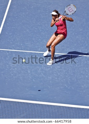 NEW YORK - SEPTEMBER 05: Venus Williams of USA returns the ball during match against Shahar Peer of Israel at US Open Tennis Championship on September 05, 2010 in New York, City.