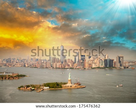 New York skyline with Statue of Liberty from helicopter. - stock photo