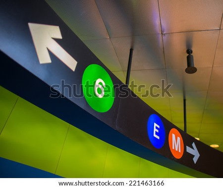 New York subway signs and geometric directions. - stock photo