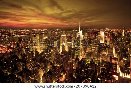 New York sunset skyline taken from the Empire State Building with gold filter - stock photo