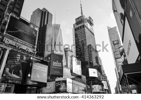 NEW YORK, UNITED STATES - DECEMBER 30, 2015 -landscape of the Big Apple illuminated skyscrapers at night in black and white times square