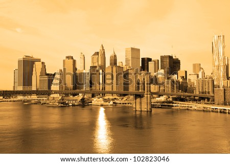 New York, United States, Lower Manhattan in the background of Brooklyn Bridge in a sunny morning, - Sephia