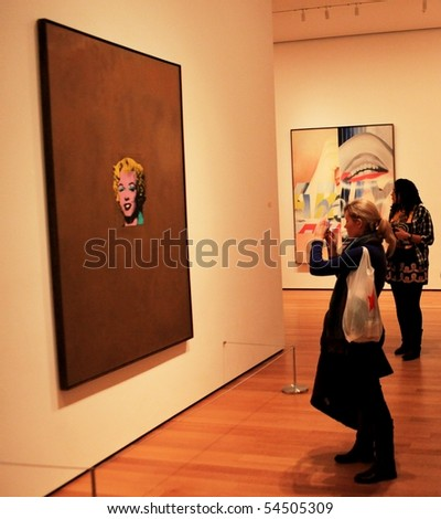 NEW YORK, US - DEC. 09: Girl taking picture of famous painting representing Marylin Monroe at Moma Museum December 09, 2009 in New York, US.