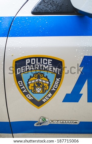 NEW YORK, US - NOVEMBER 22: Detail of door of New York Police car showing crest. November 22, 2013 in New York. - stock photo