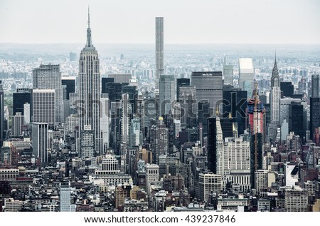 NEW YORK, USA - Apr 28, 2016:  New York City Manhattan midtown view with the Empire State Building. It is a 102-story skyscraper located in Midtown Manhattan. View from the World Trade Center - stock photo