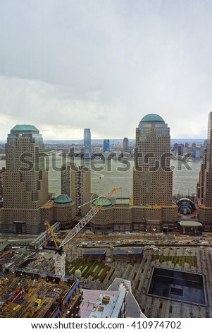 NEW YORK, USA - APRIL 23, 2015: Aerial view to National September 11 Memorial - 9/11 - of Financial District in Lower Manhattan. It is a commemoration of the terrorist attacks on September 11, 2001 - stock photo