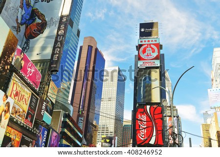 New York, USA - April 26, 2015: Broadway and 7th Avenue skyscrapers in Midtown Manhattan in New York, USA. It is called Times Square. It is a commercial junction of Broadway and 7th Avenue. - stock photo