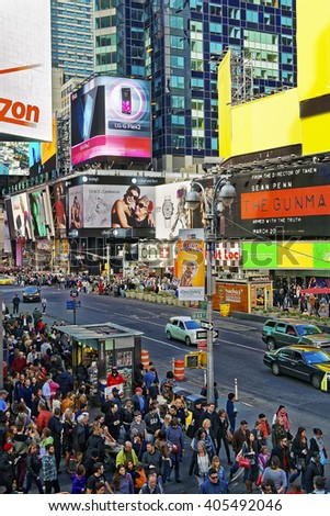 NEW YORK, USA - APRIL 26, 2015: Crowded 7th Avenue and West 44th Street in Midtown Manhattan, New York, USA. It is called Times Square. Tourists around - stock photo