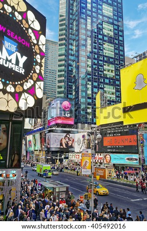 NEW YORK, USA - APRIL 26, 2015: Overcrowded 7th Avenue and West 44th Street in Midtown Manhattan, New York, USA.It is called Times Square. Tourists around - stock photo