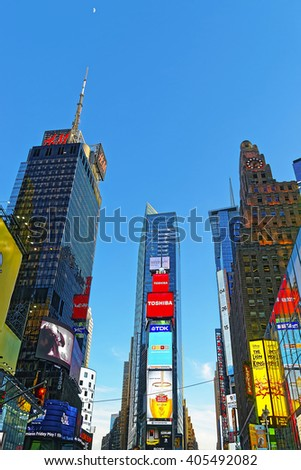 NEW YORK, USA - APRIL 26, 2015: 7th Avenue and Broadway skyscrapers in Midtown Manhattan, New York, USA. It is called Times Square. It is a commercial junction of Broadway and 7th Avenue. - stock photo