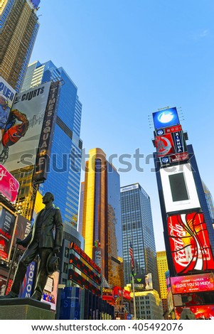 NEW YORK, USA - APRIL 26, 2015: Times Square at 7th Avenue and Broadway in Midtown Manhattan, New York, USA. It is called Times Square. Tourists around - stock photo