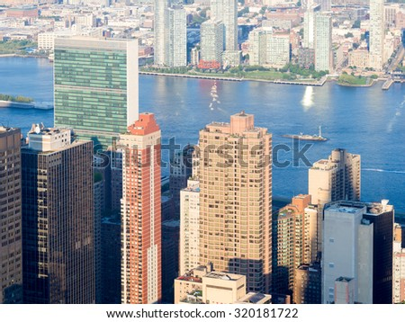 NEW YORK,USA - AUGUST 15,2015 : Aerial view of New York City with the East River and the Unted Nations Building - stock photo