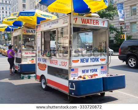 NEW YORK,USA - AUGUST 18,2015 :  Fast food cart selling hot dogs and other snack in New York City - stock photo