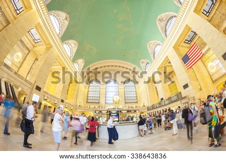 NEW YORK, USA - AUGUST 15, 2015: Fisheye lens picture of commuters in motion by the famous clock in the Grand Central Terminal main hall during busy day. - stock photo