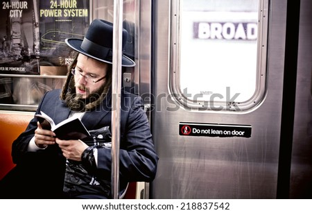 NEW YORK. USA - AUGUST 21, 2012: Jewish man reading Hebrew Bible in subway on August 21, 2012, in New York, USA - stock photo