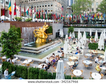 NEW YORK,USA - AUGUST 14,2015 : Lower Plaza at the Rockefeller Center with the golden statue of Prometheus in midtown Manhattan - stock photo