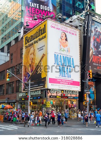 NEW YORK,USA - AUGUST 14,2015 : People and bllboards advertising Broadway musicals near Times Square in New York City - stock photo