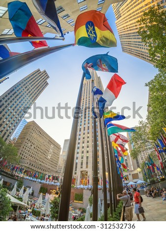 NEW YORK,USA - AUGUST 14,2015 : Tourists at the Rockefeller Center in downtown Manhattan - stock photo